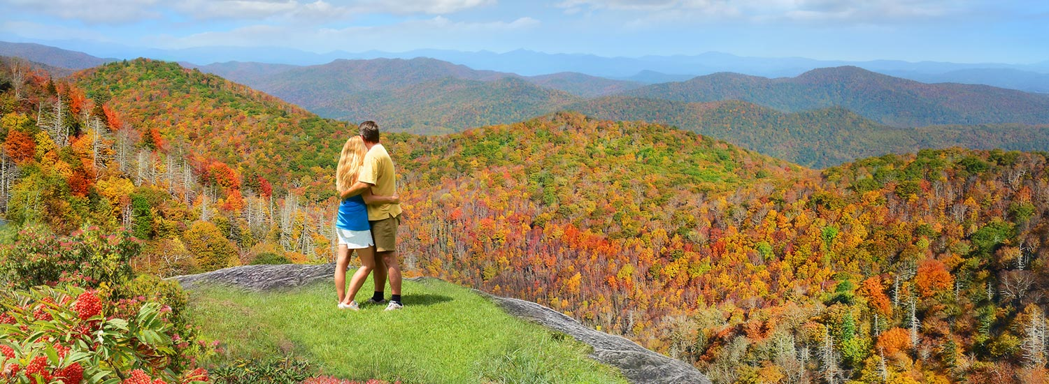 couple embracing with mountain view